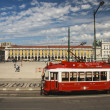 Stock Photo: Red sightseeing tram starts from downtown Commerce square Lisbon