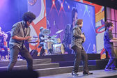 Musicians of rock band playing on iPads at opening ceremony annual IBM Impact — Stock Photo