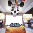 Real McLaren race and hanging upside down Formula One cars showcase SAP analytic software at Sapphire Now conference — Stock Photo
