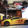 Real McLaren race and hanging upside down Formula One cars showcase SAP analytic software at Sapphire Now conference - Stock Photo