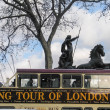 Stock Photo: London Open-top Sightseeing Bus Tour moving near Boadicestatue chariot with horses