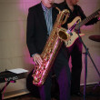 Stock Photo: Founder of IDS Scheer software company professor Scheer playing saxophone