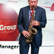 Founder of IDS Scheer software company professor Scheer playing saxophone — Stock Photo #39768507