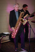Founder of IDS Scheer software company professor Scheer playing saxophone — Stock Photo