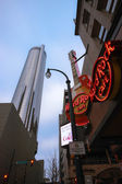 ATLANTA, GA, USA, MARCH 4, 2014 - Hard Rock Cafe near Westin Peachtree Plaza hotel on March 4, 2014 in Atlanta, GA, USA. Guitar signage was created after Eric Clapton donated his instrument in 1979 — Stock Photo