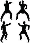 逆に男性の空手武術シルエット パンチ空手ポーズ — ストックベクタ