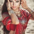 Indian woman bollywood bellydancer with wedding makeup in bridal dress dancing. Indian bride in sari. Arabian girl — Stock fotografie