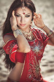 Indian woman bollywood bellydancer with wedding makeup in bridal dress dancing. Indian bride in sari. Arabian girl — Stok fotoğraf