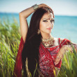 Stock Photo: Beautiful indiwombride in sari dancing bellydance. Arabibellydancer in bollywood dance