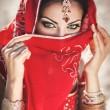 Beautiful indian woman bride in sari dancing bellydance. Arabian bellydancer in bollywood dance — Stock Photo #23295096