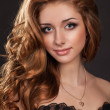 Fashion brunette woman in diamond jewelry perfect skin curly hairstyle in black dress. Alluring girl with long healthy glossy hairs and makeup beauty contest winner. Princess. — Stock Photo