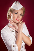 Alluring blonde woman in pin-up retro sailor costume with bright makeup and hairstyle. Beaotiful girl stewardess — Stock Photo