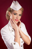 Blonde woman in white pin-up retro sailor costume with bright makeup and hairstyle. Beaotiful girl stewardess — Stock Photo