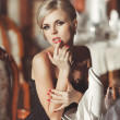 Beautiful sexy woman in restaurant — Stock Photo