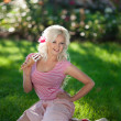Happy woman blond relaxing on green grass — Stock Photo