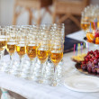 Champagne glasses on wedding table, party — Stock Photo #30550247