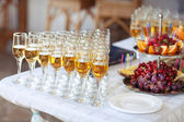 Champagne glasses on wedding table, party — Stock Photo