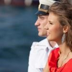 Постер, плакат: Military seaman and his girlfriend near sea