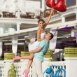Teenage couple embracing on dating with bunch of balloons hearts — Stock Photo #32655531