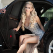 Stock Photo: Beautiful Sexy womwith long legs in luxury car