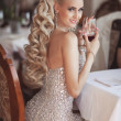 Gorgeous blonde woman with red wine glass in luxury restaurant.  — Foto de Stock
