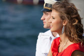 Military seaman and his girlfriend near sea — Stock Photo