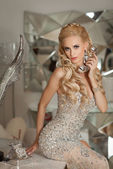 Beautiful sexy woman in luxury interior — Stock Photo