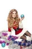 Beautiful Christmas woman in Santa Clause costume holding decorative ball. — Stock Photo
