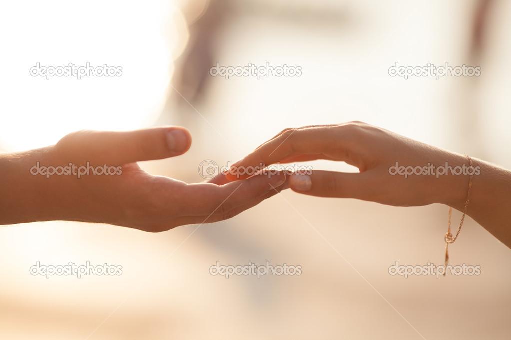 Wedding Couple Holding Hands On Sunset Stock Photo