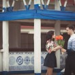 Happy couple with spring bouquet tulips — Стоковая фотография