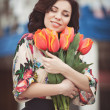 Woman with flowers bouquet — Stock Photo