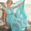 Woman in Greek style on sunset near ancient ruins. — Stock Photo #35420667