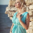 Pregnant woman on sunset near ancient ruins. — Stock Photo