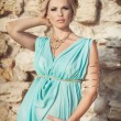 Pregnant woman on sunset near ancient ruins. — Stock Photo #35420705