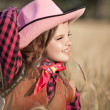 Cowboy girl in golden wheat — Stock Photo