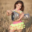 Stock Photo: Girl dancing with tamtam
