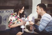 Couple in love with puppet — Stock Photo