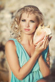 Woman with seashell in Greek style — Stock Photo