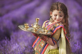 Indian girl with traditional plate of religious offerings — Stock Photo