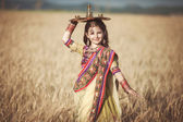Indian girl with traditional plate — Stock Photo