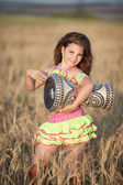 Girl dancing with tamtam — Stock Photo