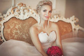 Bride in wedding dress with diamond jewelry — Stock Photo
