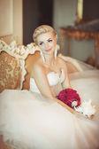Bride in wedding dress with diamond jewelry — Stock Photo