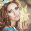 Beautiful Fantasy woman in long blue dress and seashell wreath — Stock Photo