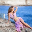 Stock Photo: Beautiful sexy wombellydancer in purple dress outdoors