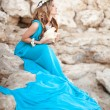 Stock Photo: Beautiful Fantasy womin long blue dress and seashell wreath