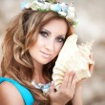Beautiful Fantasy woman in long blue dress and seashell wreath — Stock Photo