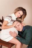 Husband hugs his pregnant wife — Stock Photo