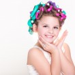 Lovely little girl portrait in curlers and pajamas, skincare kid beauty and glamour. — Stock Photo #37930441