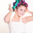 Lovely little girl portrait in curlers and pajamas, skincare kid beauty and glamour. — Stock Photo #37930473